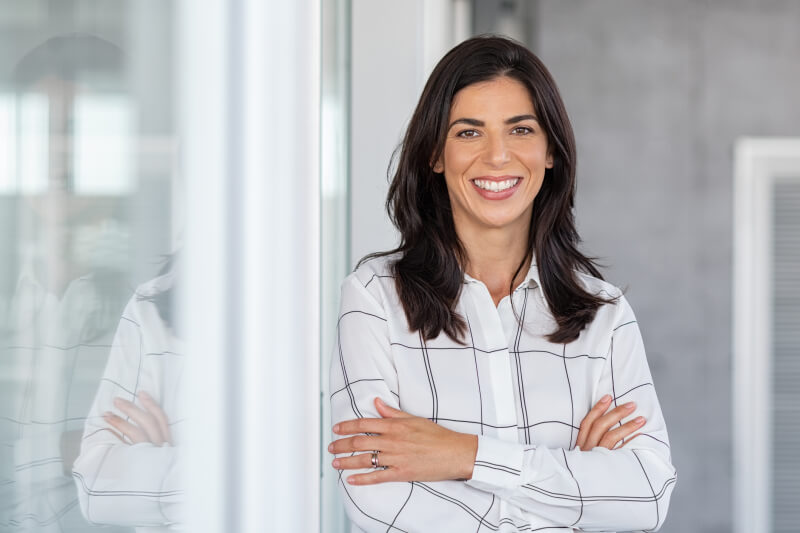 Portrait of middle aged businesswoman in modern office looking at camera