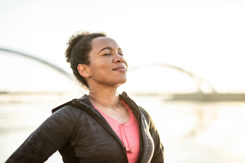 Mid adult African American woman enjoying sunrise