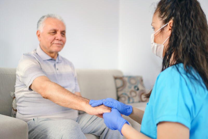 holding patient's hand for health care trust and support